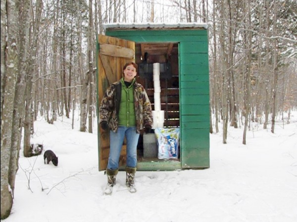 Jenny Haskell stands in front of the outhouse in Kingsbury that was pictured in a video she submitted for a Charmin toilet paper contest. Haskell submitted the video in early November and was later selected as the Maine winner. She is now vying to become one of five state winners to compete in the national contest. (Photo contributed by Jenny Haskell.)  BOWLEY STORY