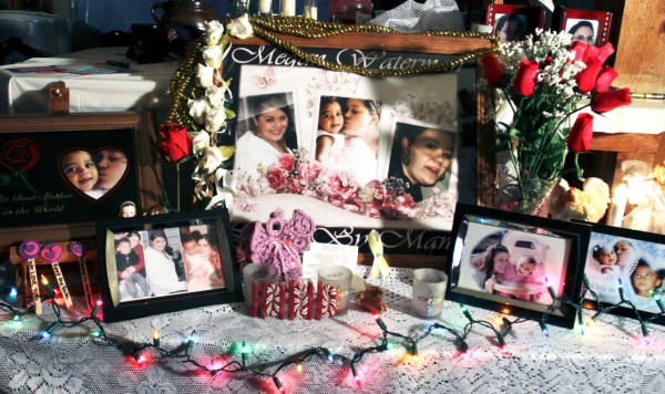 Lorraine Ela has set up a tribute to her missing daughter, Megan Waterman, 22, at her home in South Portland, Maine, on Wednesday, Dec. 15, 2010. Waterman has been missing since June and authorities say they are trying to determine whether she is one four women's bodies found along a remote beach highway on New York's Long Island. (AP Photo/Pat Wellenbach)