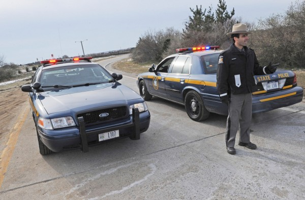 State Police block the entrance to Ocean Parkway near the area where four bodies were found earlier this week, Thursday, Dec. 16, 2010, on New York's Long Island. (AP Photo/Louis Lanzano)