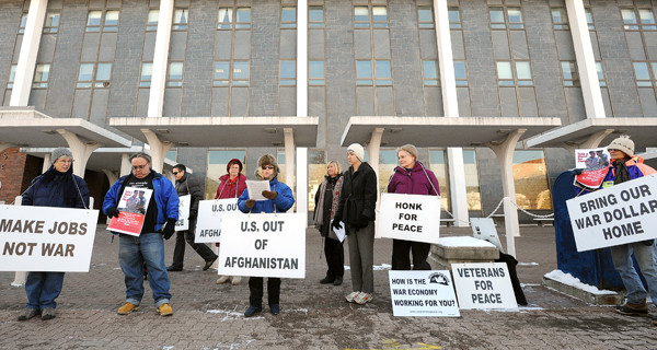 The Peace and Justice Center of Eastern Maine held a rally in front of the Margaret Chasse Smith Federal Building in Bangor Thursday, Dec. 16, 2010.  They were showing their support for Maine veterans and peace activists who traveled to Washington, D. C. to participate in the Take A Stand for Peace action. (Bangor Daily News/Gabor Degre)