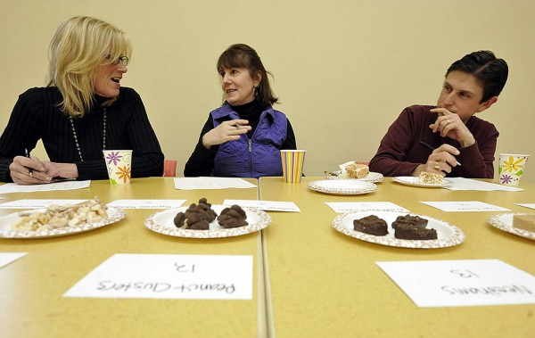 Left to right: Ann Marie Orr, Arlene Boyle and Dan Cashman compare notes as they judge the 14 entries in the  Bangor Daily News' holiday candy contest in the BDN cafeteria Tuesday , Dec. 14, 2010. (Bangor Daily News/John Clarke Russ)