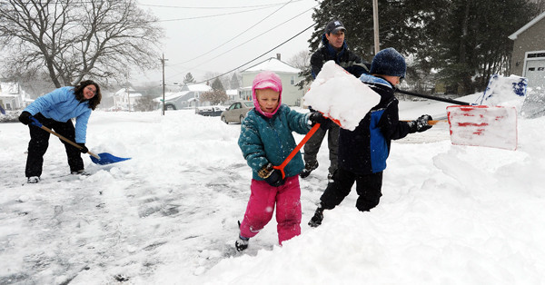 CAPTION  The Talon family of Old Town, left to right, Marion, Abbey, Mike and Gabe shovel the family driveway on Monday, December 6, 2010. Work for Marion and Mike was canceled due to the snow, allowing for a snow sledding adventure after the driveway was cleared of snow. (Bangor Daily News/Kevin Bennett)   (WEB EDITION PHOTO)