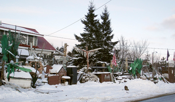 Municipal employees in Houlton will be stepping in to clean up the property at 314 Military Street owned by Jerry Cardone. An Aroostook County Superior Court order has deemed the property an illegal junkyard. Cardone, an artist, will be allowed to keep some of his existing art on a secure spot in the property, but the remaining items, including old cars, rotted wood, rusted scrap metal and other material will be disposed of by the town. Some of Cardone's work, pictured here on Thursday, Dec. 16, 2010, stands at the front of the property. (BANGOR DAILY NEWS PHOTOS BY JEN LYNDS)