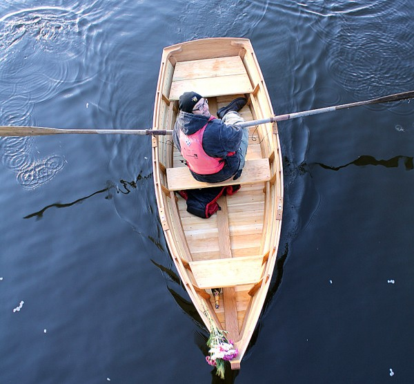 Seth Walton, of Hillsboro, Virginia, rowed his 11-foot Susan Skiff named Major Helen on Friday morning in Rockland Harbor. The boat took three months to construct by hand. Walton is an intern at the Apprenticeshop, a nonprofit that teaches wooden boat building in Rockland. (Bangor Daily News/Heather Steeves)