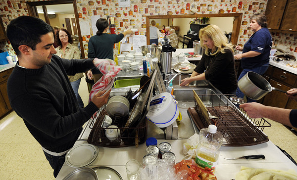 Anthony Fessenden, left, a worker at United Technologies Corporation in Pittsfield is joined by other UTC workers as they clean up the Welcome Table soup kitchen on Friday, December 17, 2010. (Bangor Daily News/Kevin Bennett)