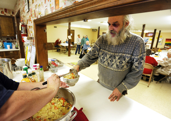Lynwood James of Pittsfield gets a bowl of soup at the Welcome Table soup kitchen on Friday, December 17, 2010. James says the food is good and adds that the Welcome Table soup kitchen allows him to meet new people as well as play cribbage. (Bangor Daily News/Kevin Bennett)