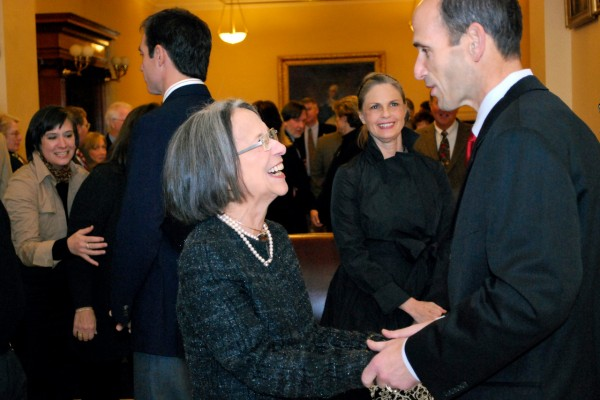 This photo provided by the Maine Governors office, Governor John E. Baldacci greets artist Jean Pilk of Cape Elizabeth during his official portrait unveiling at the Maine State House in Augusta on Saturday, Dec. 18, 2010. In the background center is Donna McNeil, Director of the Maine Arts Commission.  (AP Photo/Maine Governors Office, Tiffany Bates)