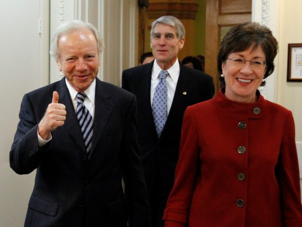 Sen. Joseph Lieberman, I-Conn., left, gives thumbs up with Sen. Susan Collins, R-Maine., right, and Sen. Mark Udall, D-Colo., as they head into a new conference about the passage of the &quotDon't Ask Don't Tell&quot bill during a rare Saturday session on Capitol Hill in Washington Saturday, Dec. 18, 2010.  (AP Photo/Alex Brandon)