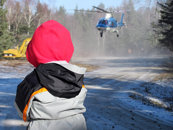 Malcolm Bahn, 4, watches as Santa takes off in a helicopter during a Flying Santa event on Saturday, December 18, 2010 in Owls Head. Bahn, the son of Mike Bahn and Brierley Ostrander, wouldn't let his family leave until he saw take-off.  (Bangor Daily News/Christopher Cousins)