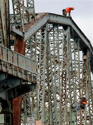 New Hampshire transportation officials inspect the Memorial Bridge connecting Portsmouth, N.H., with Kittery, Maine, Tuesday, Nov. 30, 2010, in Portsmouth. The Through Truss Left bridge opened in 1923 and was closed for inspection as Maine and New Hampshire officials figure out how to replace or repair the historic bridge that connects the two states. (AP Photo/Jim Cole)