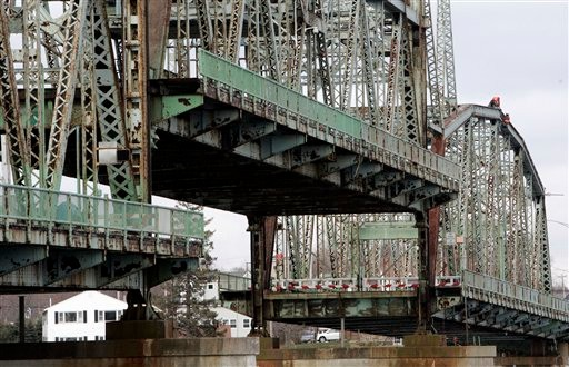New Hampshire transportation officials, upper right, inspect the Memorial Bridge connecting Portsmouth, N.H., with Kittery, Maine, Tuesday, Nov. 30, 2010, in Portsmouth. The Through Truss Left bridge opened in 1923 and was closed for inspection as Maine and New Hampshire officials figure out how to replace or repair the historic bridge that connects the two states. (AP Photo/Jim Cole)