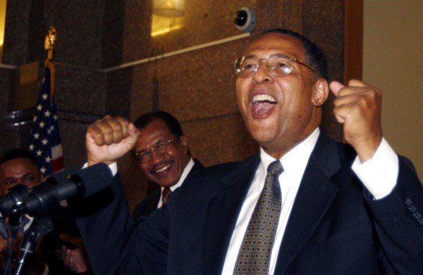 Roderick L. Ireland, newly sworn in as chief justice, reacts after the ceremony, Monday, Dec. 20, 2010, in Boston. Ireland was sworn in as the first black chief justice of the Supreme Judicial Court. (AP Photo/Bizuayehu Tesfaye)