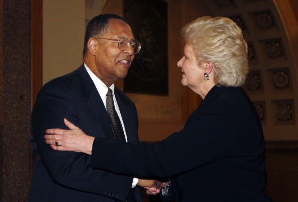 Massachusetts Chief Justice Margaret Marshall, right, who's retiring to spend more time with her ailing husband, congratulates Roderick L. Ireland, newly sworn in as chief justice, after the swearing ceremony, Monday, Dec. 20, 2010, in Boston. Ireland was sworn in as the first black chief justice of the Supreme Judicial Court. (AP Photo/Bizuayehu Tesfaye)