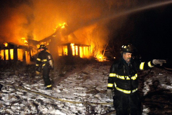 Bangor firefighters responded shortly after 6 p.m Monday to a house fire on a dead end section of  Pushaw Road off Finson Road in Bangor.  (Bangor Daily News/John Clarke Russ)