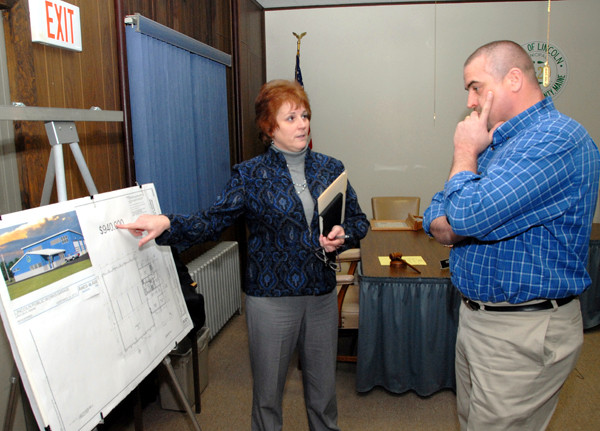 Lincoln Town Manager Lisa Goodwin explains the town's proposal to build a new public works garage for $1.15 million to Town Councilor Curt Ring prior to a council meeting on Monday, December 20, 2010. The council unanimously agreed to hold a public hearing on whether to take the garage proposal to a special referendum on Jan. 10.