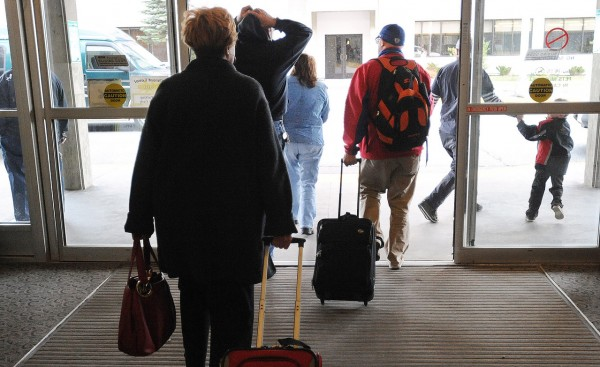 CAPTION  Travelers leave the Bangor International Airport Wednesday, Nov. 24, 2010.  Millions of people throughout the country travel to see family on the day before Thanksgiving, which is said to be one of the year's busiest travel days. (Bangor Daily News/Gabor Degre)    (WEB EDITION PHOTO)