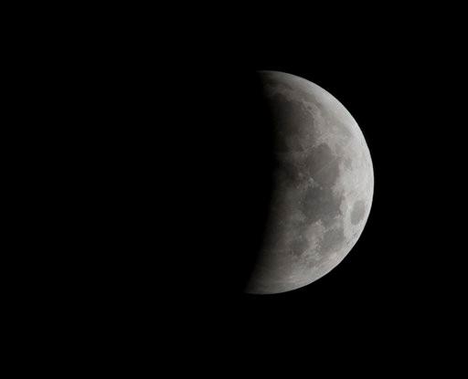 The moon is shown at 2:04am EST during an eclipse seen near Gainesville Fla., Tuesday, Dec. 21, 2010,  (AP Photo/Phil Sandlin)