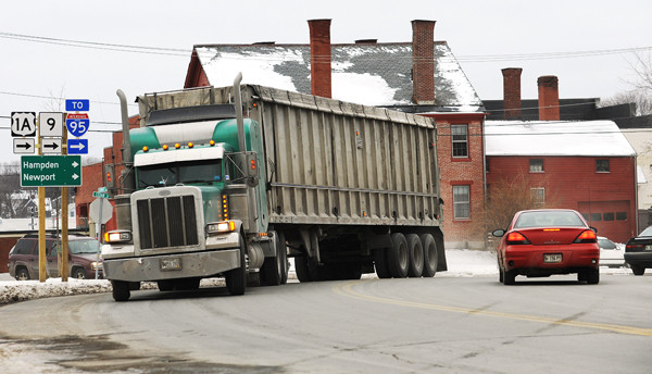 A trailer truck turns the corner by the Bangor Police Station on Summer Street in Bangor on Monday, December 20, 2010. Trucks weighing over 80,000 pounds are returning to city streets and rural routes through many small villages due to the recent expiration of a pilot program that allowed them to travel on interstate highways north of Augusta. (Bangor Daily News/Kevin Bennett)