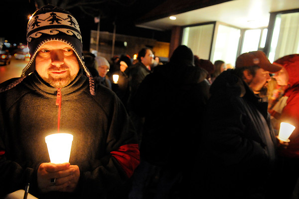 Holding a freshly lit candle, Daniel Flagg of Bangor joined dozens of others in front of the Bangor Area Homeless Shelter for Bangor's annual Homeless Memorial Day vigil walk Tuesday evening, Dec. 21, 2010. Flagg said he was homeless for a spell until a few weeks ago. &quot I didn't realize the homeless situation until I was homeless myself, &quot said Flagg. Flagg added that he hopes to volunteer his time to help other homeless persons.  (Bangor Daily News/John Clarke Russ)