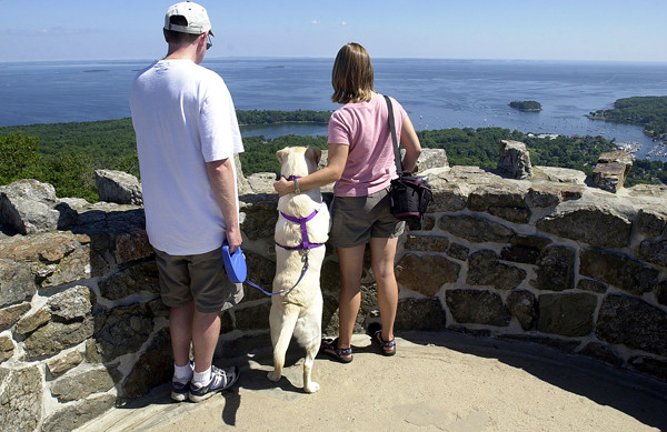 &quotI ... SAW THREE ISLANDS IN A BAY&quot    Edward and Jennifer Smith from Plattsburg, N.Y., enjoy the view of Camden from the tower on Mount Battie on Monday. Between them is their dog Molly. (BANGOR DAILY NEWS PHOTO BY LINDA COAN O'KRESIK)