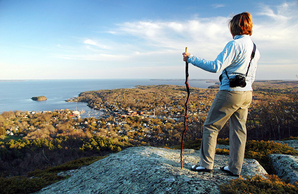 Rebecca Cooper pauses to take in the view of Camden Harbor during her climb on Mount Battie. The scene provided the inspiration for Edna St. Vincent Millay's poem &quotRenascence.&quot (AP Photo/Robert F. Bukaty)