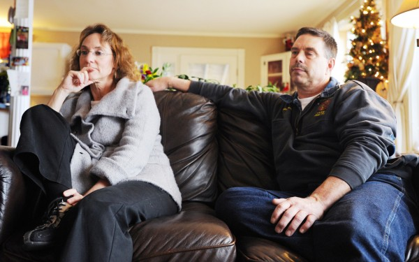 Capt. John Prentiss of the Bangor Fire Dept., right, and his wife Barby sit at their Dedham home discussing John's recent heart attack while on duty responding to an emergency call.  (Bangor Daily News/Kevin Bennett)