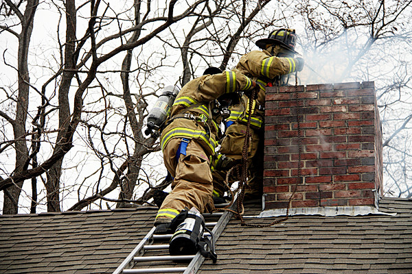 Rockland firemen worked for two hours to extinguish a chimney fire that started at about 1 p.m. Wednesday at a residence on Lake Avenue. According to Lt. Jamie Leo, of the Rockland Fire Department, his men had to use chains to reduce soot buildup in the chimney first. After doing that, the firefighters were able to toss a dry chemical extinguisher into the chimney. No one was injured and the house was undamaged. Leo said people should have their chimneys cleaned at least once per year to avoid buildup. PHOTO COURTESY ROCKLAND FIRE DEPARTMENT