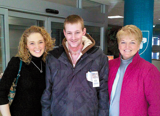 Courtney Wetzel, far left, poses with her husband, Zane Wetzel, and her mother, Paula Hartin, in Boston last week. Zane Wetzel, who was electrocuted in an industrial accident while working as an apprentice lineman for Maine Public Service Co. on Oct. 12, will be back in Aroostook County for Christmas. He has not been home to Mars Hill since the accident. (PHOTO COURTESY OF COURTNEY WETZEL)