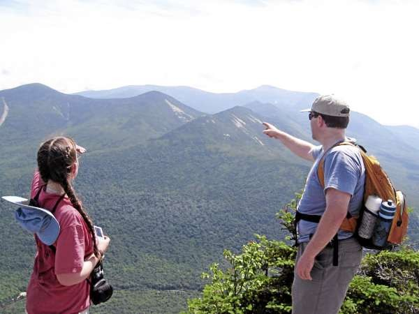 Erica Bartlett and her brother Jeremiah point out landscape features from Doubletop Mountain. The hikers were among a number of others who, throughout the year, made Brad Viles' hiking season memorable. Brad Viles photo