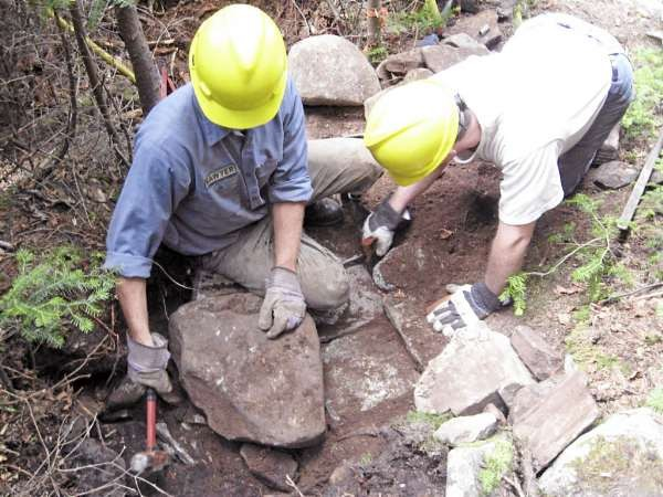 Working with the Maine Trail Crew was a high point of the hiking year for Brad Viles. Here, Chris Binder, left, and Steve Foley set rocks in place for a waterbar on the Appalachian Trail. Brad Viles photo