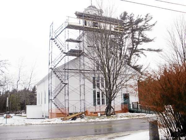 Joni's column, Saturday, Dec. 25 Holden Congregational Church with work in progress repairing the steeple of the church built in 1828. (NEWS photo by Joni Averill)