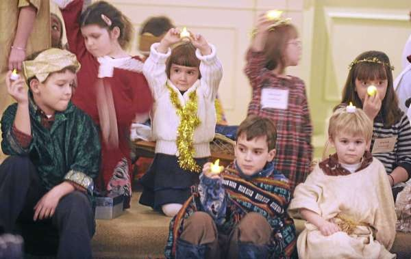 Children hold lights up representing stars while acting out the Nativity during the family Christmas Eve Service at the Church of Universal Fellowship in Orono Friday afternoon.  About 15 youngsters participated in the service that was lead by the reverend Lorna Grenfell. (Bangor Daily News/Gabor Degre)