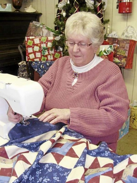Joline Frazier of Brownville, a member of the Monday Morning Quilters, worked on a red, white and blue quilt top destined for the Quilts of Valor Foundation, Monday at the Brownville United Methodist Church. The foundation provides quilts for servicemen and women affected by the war. (Bangor Daily News Photo by Diana Bowley)