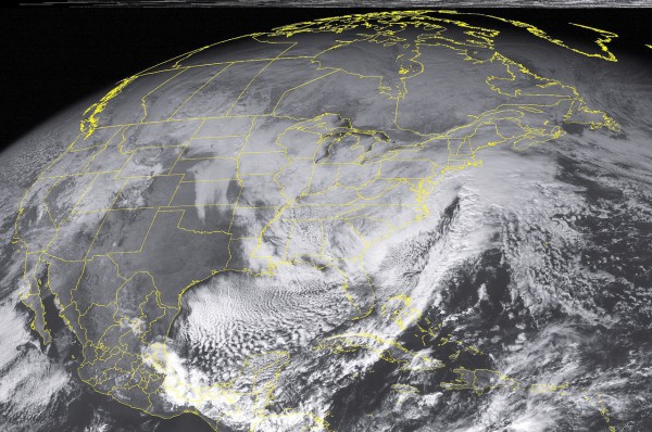 This NOAA satellite image taken Sunday, December 26, 2010 at 12:45 PM EST shows fairly widespread cloud cover over the eastern half of the nation as a trough of low pressure hangs over the region and a dangerous winter storm affects southern New England and Mid-Atlantic.  The storm system continues to intensify off the North Carolina coast through the afternoon.  Bands of heavy snow and strong winds of 15 to 25 mph with frequent gusts to 45 mph develop along the coasts of these region, creating blizzard conditions with blowing and drifting snow.  The New England coast remains under a Blizzard Warning through the afternoon.  Extremely dangerous travel conditions are expected across the region.  Expect reduced to visibilities reaching near zero and widespread power outages during the height of the storm.  Residents in these regions are encouraged to monitor their local weather activity and take proper precautions against the upcoming dangerous weather event.  Meanwhile, light to moderate bands of snow cover the Tennessee Valley, much of the Southeast, and the Appalachians.  A variety of Winter Weather Advisories, Winter Storm Warnings, and Wind Advisories remain over these regions through the afternoon. (AP PHOTO/WEATHER UNDERGROUND)