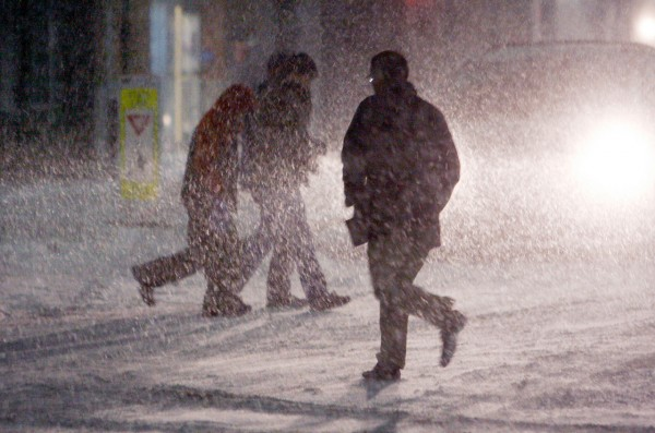 Shoppers scurry through heavy snowfall in the parking lot at Shoppers World in the Boston suburb of  Framingham, Mass., Sunday, Dec. 26, 2010. (AP Photo/Bill Sikes)