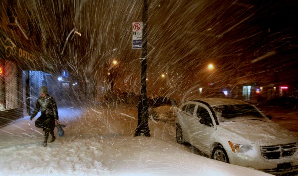 A pedestrian walks along 72nd Street in New York Sunday, Dec. 26, 2010, in the midst of a blizzard that hammered New York and much of the Northeast. (AP Photo/Craig Ruttle)
