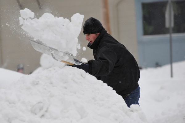 14-year-old Matt Townsend helped his family dig out from under the white stuff at their home on Parkview Ave. in Bangor as the snowstorm continued to blast Maine Monday morning. Townsend said he had been shoveling periodically since 3 a.m Monday. &quotThis storm has to be the worst so far. The plow trucks keep plowing us in,&quot he said.  (Bangor Daily News/John Clarke Russ)