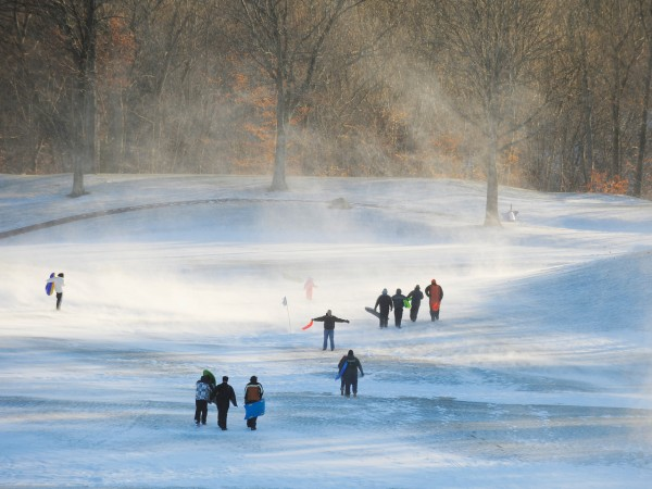 People at the Municipal Golf Course in Norwich, Conn., enjoy the cold and wind-blown snow Monday, Dec. 27, 2010. Sunday's blizzard dumped 6-8 inches of snow in the region. (AP Photo/The Day, Sean D. Elliot) MANDATORY CREDIT; MAGS OUT; INTERNET OUT; NO SALES