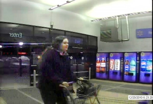 Bangor Police Dept. is searching for this woman (seen in store surveillance image) who allegedly took presents from a car at WalMart in Bangor on Dec. 20, 2010 . courtesy of Bangor Police Dept.
