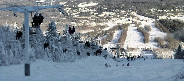 This photo provided by Al Noyes shows skiers and lift chairs on the slope, lower right, after a lift derailed on the state's tallest mountain in Carrabassett Valley, Maine, Tuesday, Dec. 28, 2010. (AP Photo/Al Noyes) NO SALES