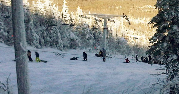 This photo provided by Al Noyes shows skiers and lift chairs on the slope after a lift derailed on the state's tallest mountain in Carrabassett Valley, Maine, Tuesday, Dec. 28, 2010. (AP Photo/Al Noyes)  NO SALES