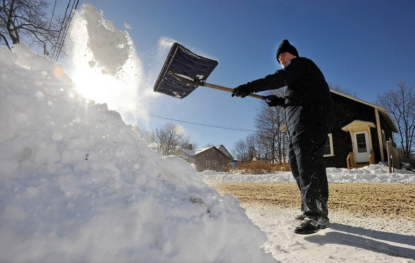 Bob Worcester took adavantage of Tuesday's sun to shovel out his driveway on Grove Street in Bangor. &quot If you pace yourself, it's good exercise,&quot said the 63-year-old Worcester of shoveling snow. &quot I'll be a little  sore later. &quot   (Bangor Daily News/John Clarke Russ)