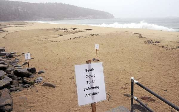 Signs posted at Sand Beach in Acadia National Park Saturday morning, September 4, 2010. National Park officials decided to reopen the Park Loop Road shortly after 6am Saturday as Hurricane Earl weekened and passed far enough from the area not to cause dangerous surf. (Bangor Daily News/Gabor Degre)