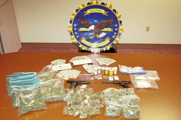 Evidence seized by Maine Drug Enforcement Agents during a search warrant executed at the home of Byron Nadeau, 61, of Eagle Lake. Agents seized  over a half pound of cocaine valued at nearly $26,000, three and a half pounds  of marijuana, $2,113 in cash, two handguns, eight long guns and an assortment of  Ecstasy and prescription drug tablets, including hydrocodone and oxycodone.  (PHOTOS COURTESY OF THE MAINE DRUG ENFORCEMENT AGENCY) w/Lynds story