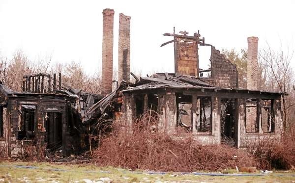 The charred remains of a house of Pushaw Road Extension in Bangor as seen on Tuesday, December 21, 2010. A local transient, Justin Landry, 21, was arrested and charged Wednesday with felony arson for his role setting the blaze. (Bangor Daily News/Kevin Bennett)