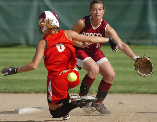 South Portland's Danielle DiBiase (left) slides into second as Bangor's Mariah Cassum anticipates the throw in the third inning of their Class A softball championship game at Saint Joseph's College in Standish on Saturday, June 19, 2010. DiBiase was safe on the play and South Portland won 1-0.