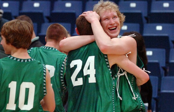 Schenck senior Cody LeVasseur (right) is all smiles as he hugs Brandon Theriault (24) following their win over Richmond for the boys Class D championship at the Augusta Civic Center on Saturday, Feb. 27, 2010. Schenck won 65-43.