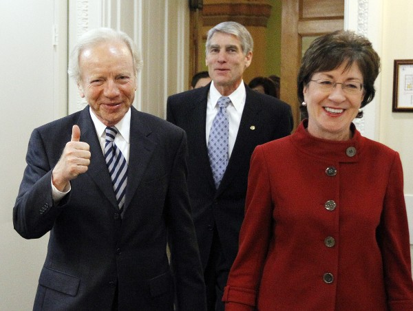 Sen. Joseph Lieberman, I-Conn., left, gives thumbs up with Sen. Susan Collins, R-Maine., right, and Sen. Mark Udall, D-Colo., as they head into a new conference about the passage of the &quotDon't Ask Don't Tell&quot bill during a rare Saturday session on Capitol Hill in Washington Saturday.