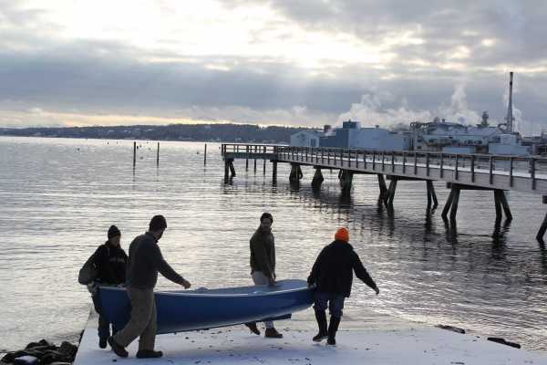 People from the Apprenticeshop, a nonprofit wooden boatbuilding school in Rockland, carried an 11-foot Frank Day rowboat down a snowy ramp Friday morning before apprentices and members of the public took the newly-finished boat took its inaugural paddle.