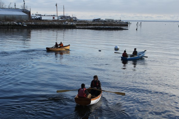 Six rowboats built by apprentices and interns at the Apprenticeshop, a nonprofit wooden boatbuilding school in Rockland, were paddled around Rockland Harbor for the first time Friday morning.